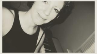 Elizabeth Joan Kelly, candid head shot with keyboard, black and white