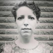 Elizabeth Joan Kelly, serious head shot, black and white