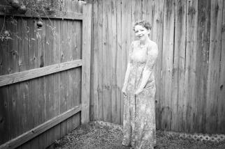Elizabeth Joan Kelly, smiling full body portrait, black and white