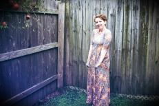 Elizabeth Joan Kelly, smiling full body portrait, color