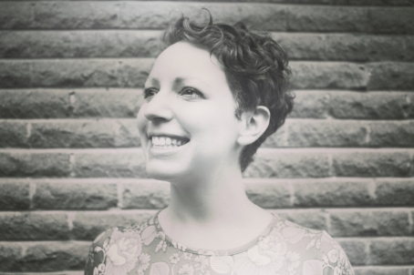 Elizabeth Joan Kelly, smiling head shot, black and white